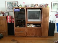 brown wooden TV hutch with gray CRT television