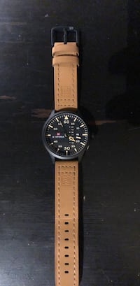 round black analog watch with brown leather strap Broomfield, 80023