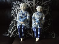big figurine boy and girl sitting, blue/white