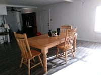 rectangular brown wooden table with four chairs dining set Houston, 77032