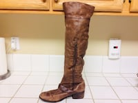 pair of brown leather boots