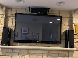 """Home theater including 50"""" TV, 3 speakers, receiver, and universal remote"""