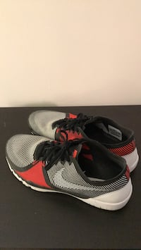 pair of gray-and-red Nike running shoes Toronto, M1K 4G3