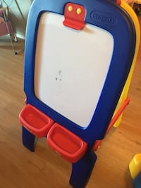 toddler's blue, yellow, and red Crayola double easel