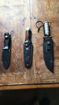 Three knives in sheaths