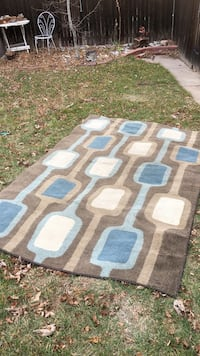 White, blue, and grey area rug