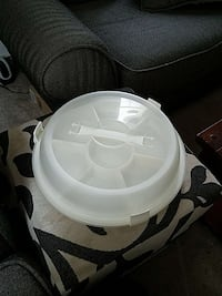 white plastic container with handle