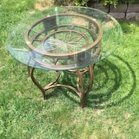 Round clear glass top table with black metal base 625 km
