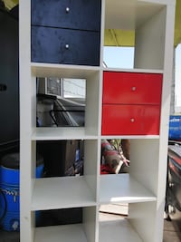 White, red, and blue wooden rack 1136 mi