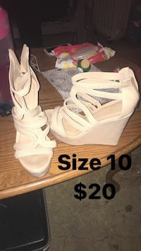 pair of size 10 white wedge sandals
