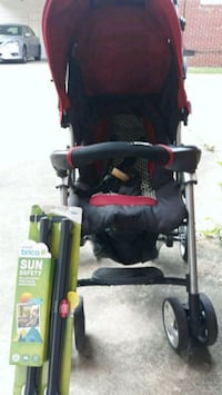 Slighty used Combi stroller and new sun shade for