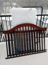 baby's brown wooden crib Saint-Eustache, J7R 5G3