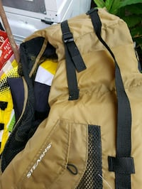 brown and black zip-up jacket Maple Ridge, V2W 1P5