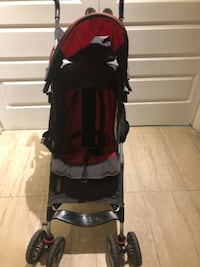baby's black and red stroller MONTREAL