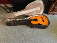 brown and black acoustic guitar with case SAINTCATHARINES