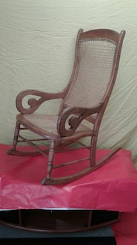 brown wooden-framed rocking armchair