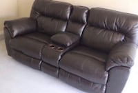Leather reclining loveseat with console. Parkville, 21234