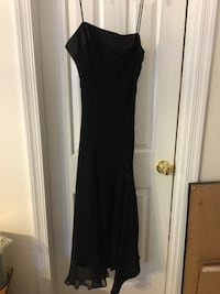 Black evening dress. Gia & Co. from Georgetown Mall.  Very elegant and tuxedo like material detailed at the top. Size 4 but runs big so anyone up to size 6/8 can wear. Like new. Only worn 1x. Please check out my other listings Gaithersburg