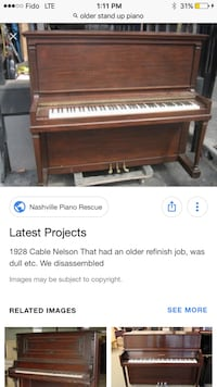 brown wooden upright piano screenshot Toronto, M5V 1P6