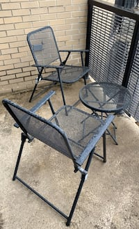 Black metal patio chairs with table