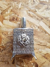 silver collectible perfume bottle