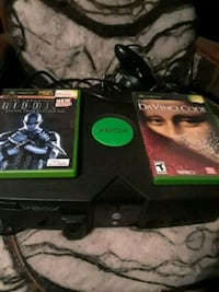 black Xbox One console with controller and game cases Indio, 92201