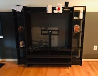 black wooden TV stand with flat screen television Owings Mills, 21117