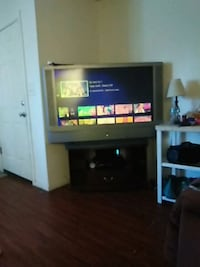 black flat screen TV with black wooden TV stand North Las Vegas, 89030