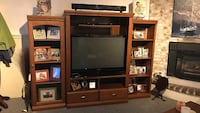 Black flat screen TV; brown wooden TV hutch St Catharines, L2P 3P7