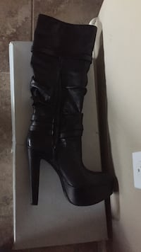 pair of black leather heeled boots Queen Creek, 85142