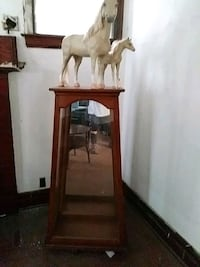 Glass 4 shelve cabinet with two horses on top  Detroit, 48202