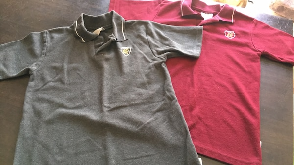 Two black and red polo shirts 73635031-6ea5-412b-b14d-bc524d0fdb73