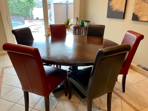 Wood round dining table + 6 leather chairs.