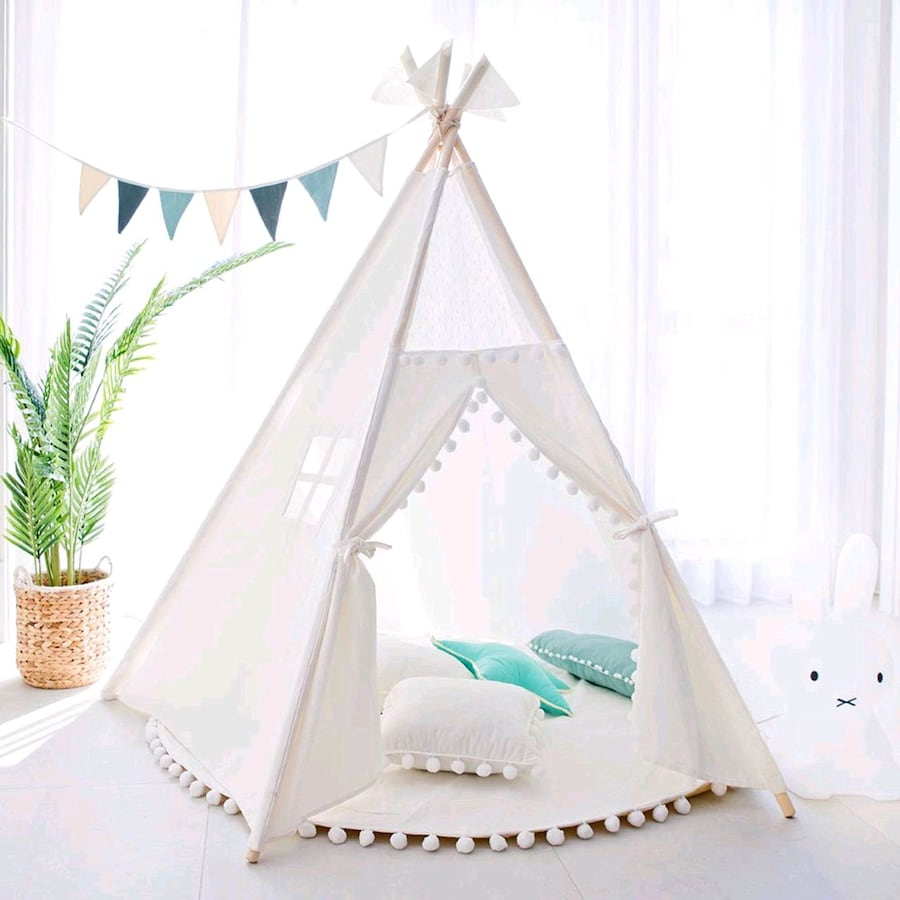 White teepee tent with round pompom mat
