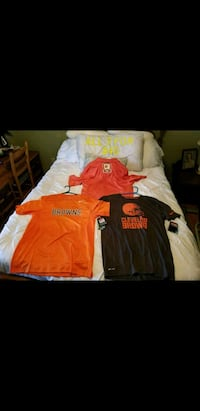 two orange and one black Cleveland Browns t-shirts