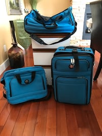 Three blue softside luggage bag carry on set