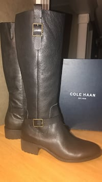 Pair of women's black cole haan leather knee-high biker boots Las Vegas, 89107
