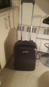 Delsey Hard Shell Rolling Luggage