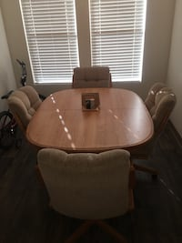 MOVING AND MUST SELL - Dining table and 4 rolling captains chairs for sale. In excellent condition. $200... Henderson, 89014