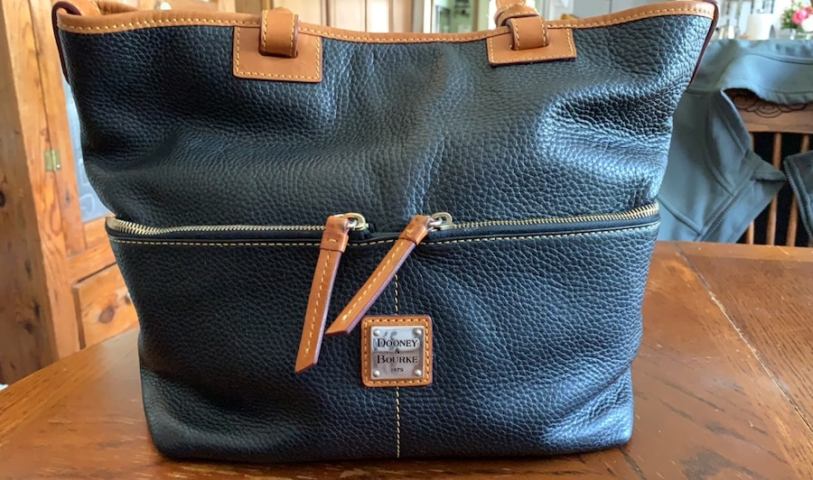 Photo Dooney and Bourk black purse or bag