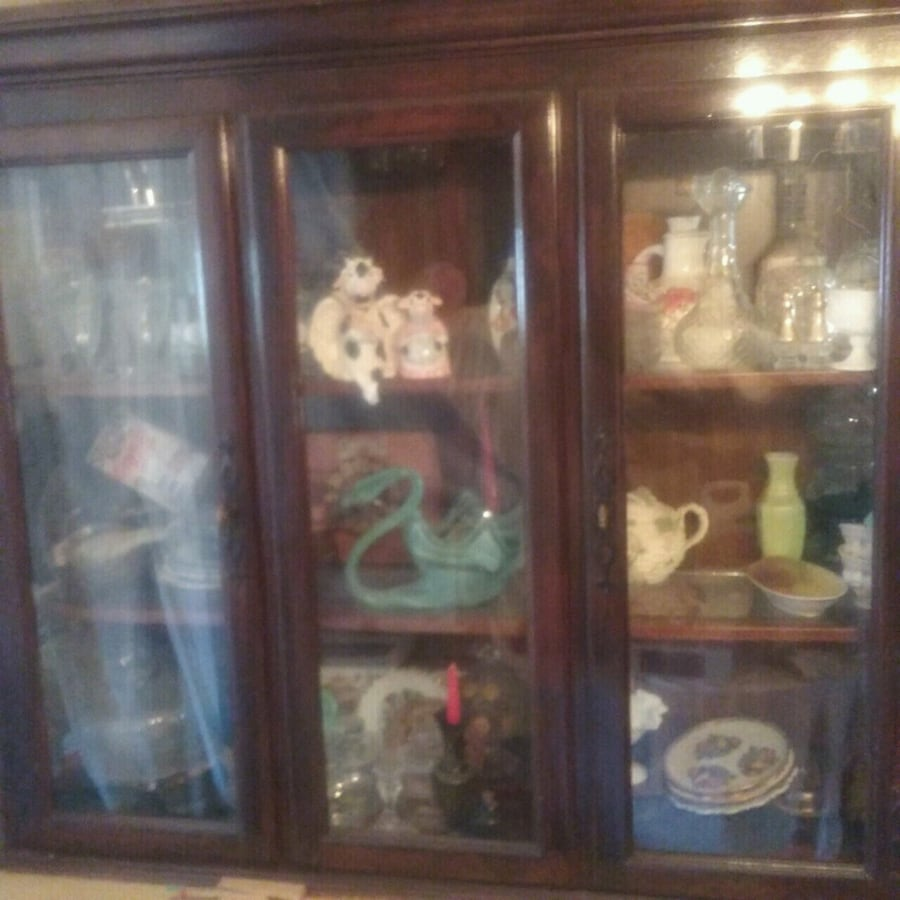top of a hutch w/ light and glass shelves