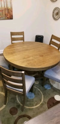 round brown wooden table with four chairs dining set District Heights, 20747