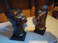 carved wooden heads one of a kind