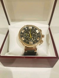 round gold-colored chronograph watch with box 941 mi