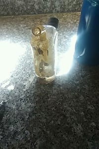 clear glass bottle with white lid Bakersfield, 93306