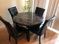 Round gray and black top table with four matching black  chairs dining set Pickering