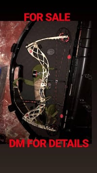 black and green compound bow in case Niagara Falls, L2G 3V9