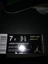 Pair of black-and-purple air jordan shoes        Never used Chicago, 60617
