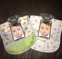 Set of 2 BNIP Kushies 12m+ baby feeding bibs with pockets. Retails $6 plus taxes. Both for $5. Pu at Kipling and highway 7 Woodbridge  Vaughan, L4L 1Z2