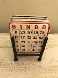4 vintage game coasters. Sturdy ceramic coasters have cork backing and a handsome metal stand  Never used. Potomac, 20854
